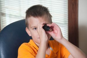 Boy using a monocular